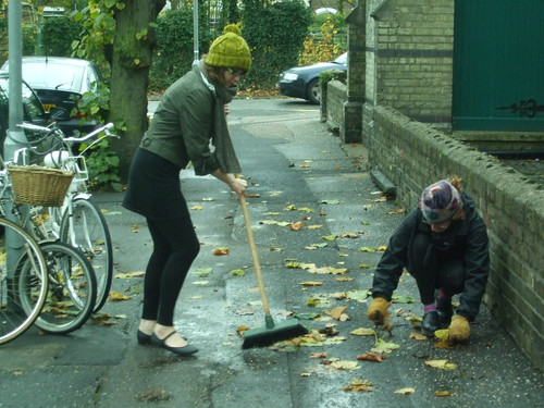 Sweeping up street leaves for making into leaf mold | by London Permaculture
