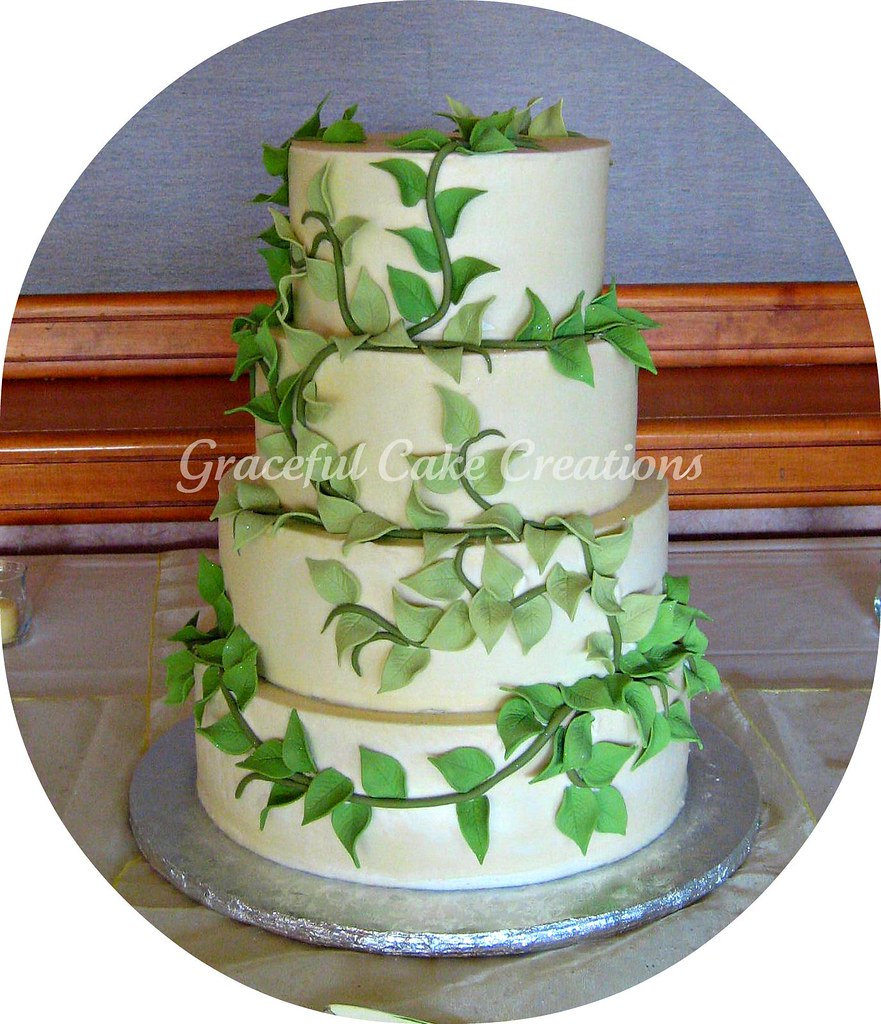 wedding cake with green leaves ivory wedding cake with green leaves grace tari 26903