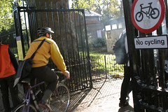 No Cycling sign in London park; cyclist ignoring | by carltonreid