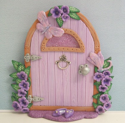 Pink fairy door handmade in polymer clay with the for Pink fairy door