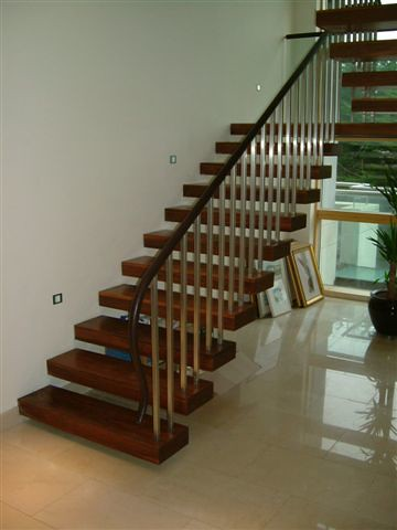 ... Cantilevered Solid Walnut Staircase With Leather Handrail | By Lavin  Architects