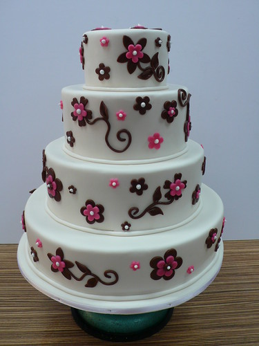 White Fondant Wedding Cake With Pink And Brown Flowers 1