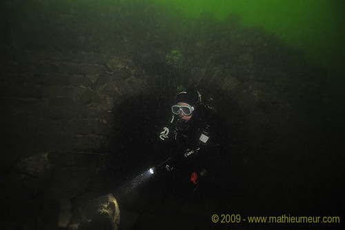 Diver exploring the Great Wall of China underwater | by Mathieu Meur