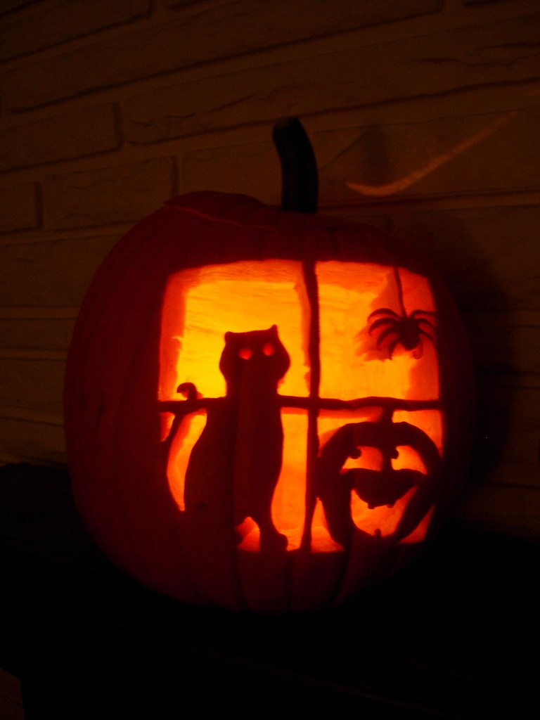 Cat pumpkin spider in window carving carved by navema for Cat pumpkin designs to carve