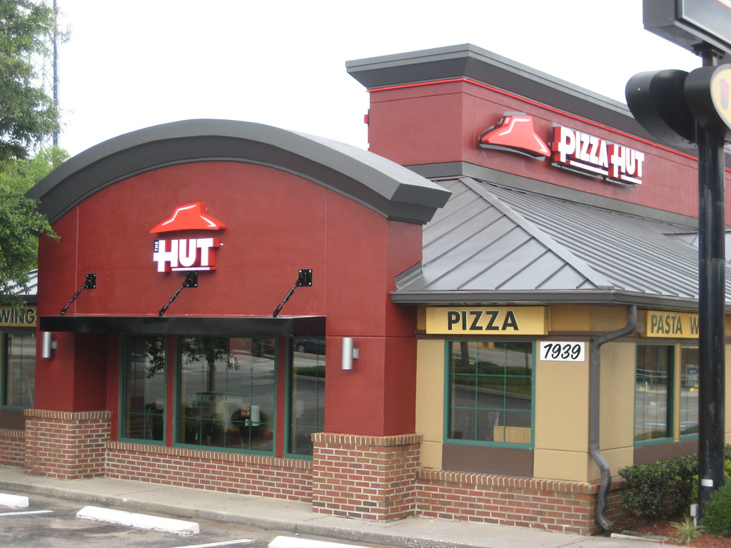 With a significant decline in sales, Pizza Hut is responding to the tough economic times by launching a new branding strategy. Will 'The Hut' make you want to eat out again?