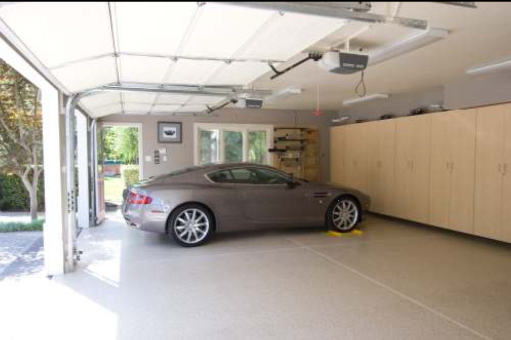 nice 3 car garage with custom color chipped floor and full flickr. Black Bedroom Furniture Sets. Home Design Ideas