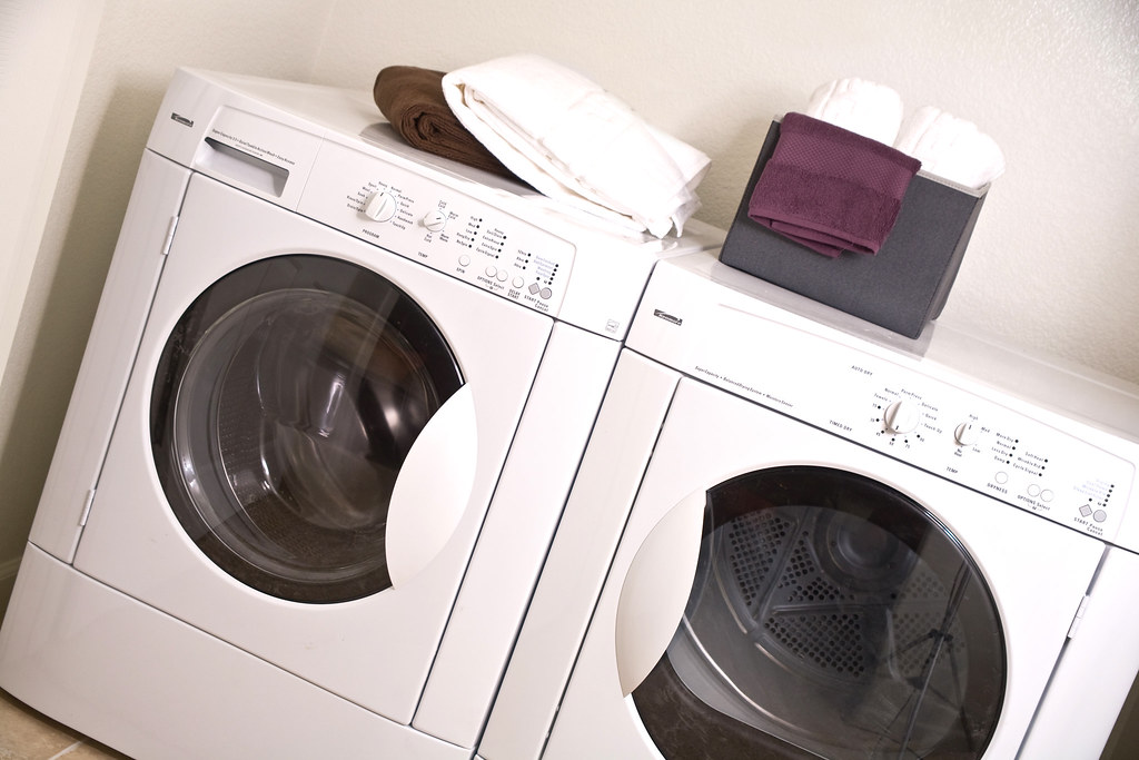 full size front loading washer and dryer included in each