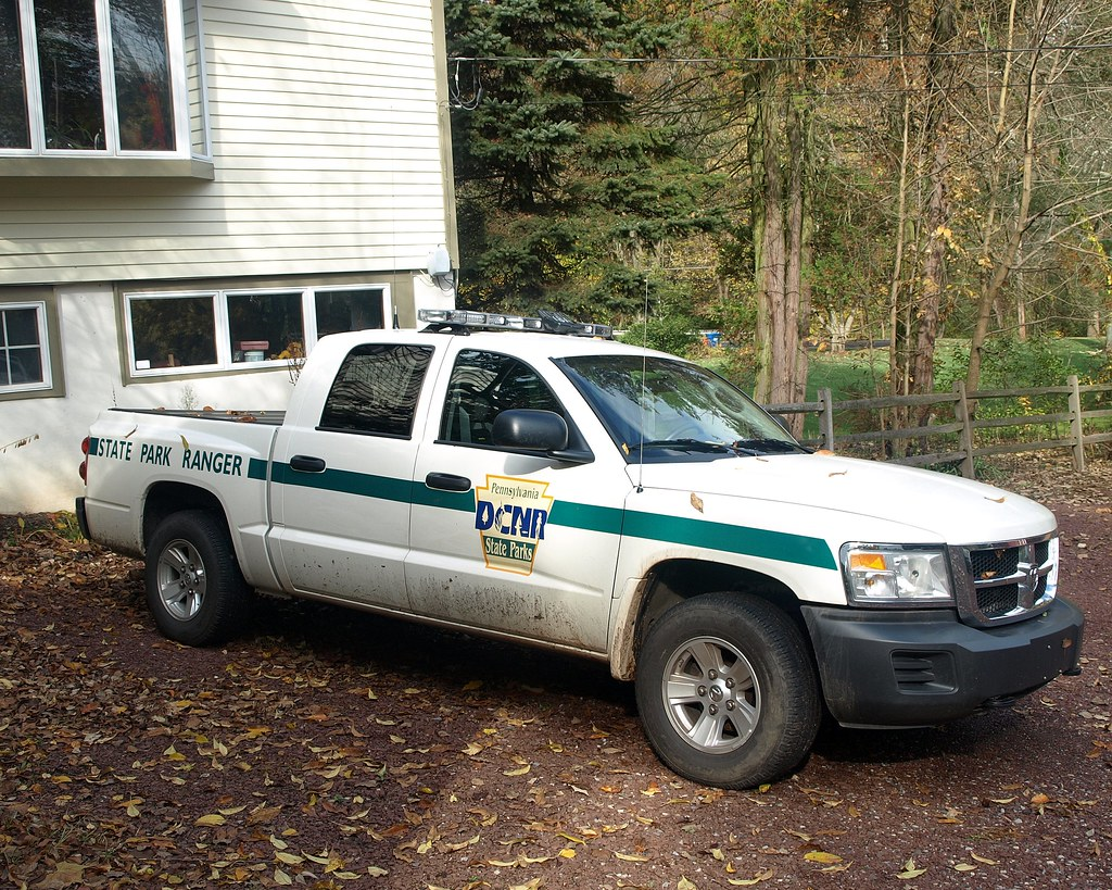 park ranger Define park ranger: a person in charge of managing and protecting part of a national park.