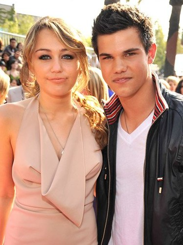 Photo of Taylor Lautner & his friend musician  Miley Cyrus - Longtime
