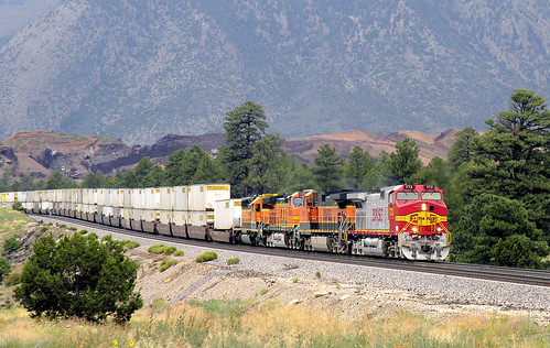 J.B. Hunt intermodal train eastbound led by GE C44-9W 4400 horsepower locomotive 773, with 2 more C44-9W and an EMD 3000 horsepower SD40-2, on BNSF, ex-Santa Fe, trackage, Flagstaff, Arizona, August 16, 2005. | by Ivan S. Abrams