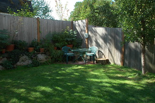 Small triangular patio in the backyard of a northend townh ...