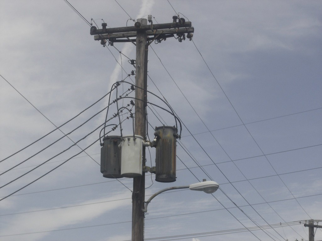 3866854610_83cbcea9a9_b old power pole with transformers,wires and a streetlight flickr