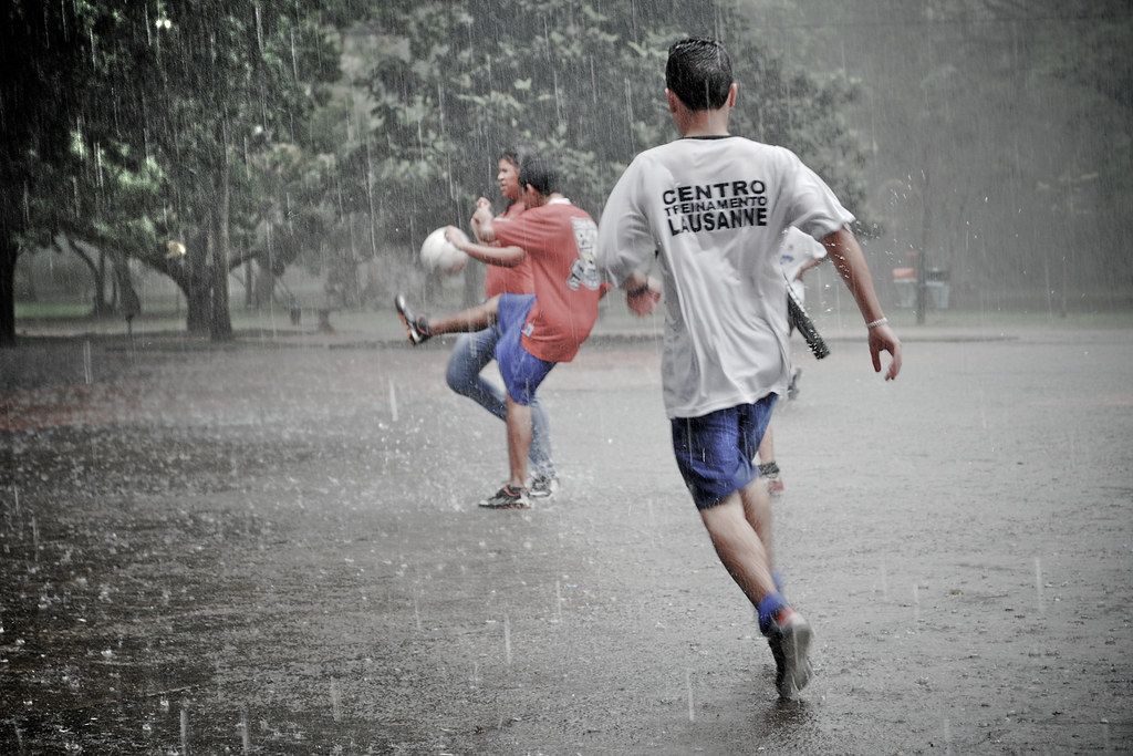 playing soccer in the rain
