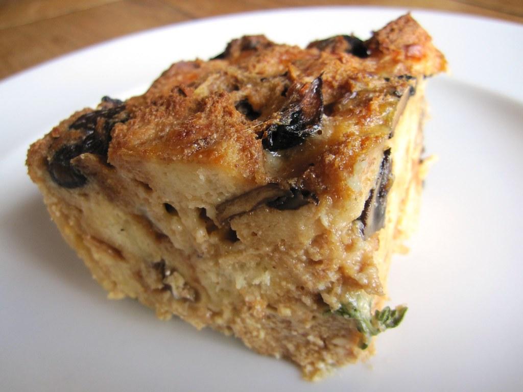 Roasted wild mushroom bread pudding slice | A slice of ...