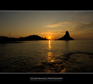 Acitrezza - The sun rises up and reflects on water | by ciccioetneo