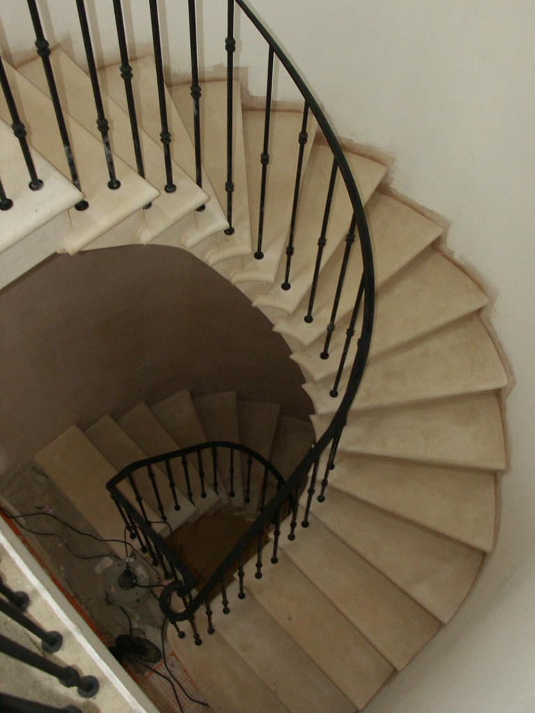 Spiral stone staircase  Atelier 109  cantilever staircase