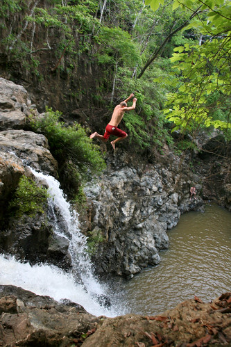 Jumping a tropical waterfall | by Christian Haugen