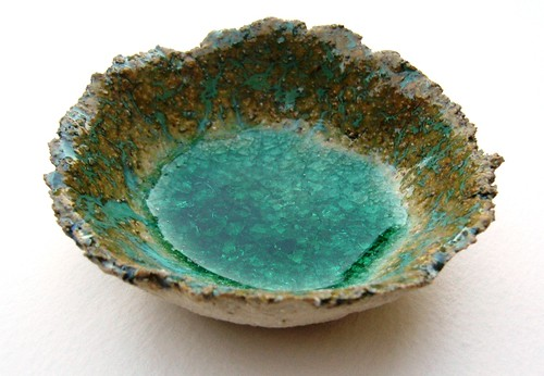 ceramic dish with glass melted in the base