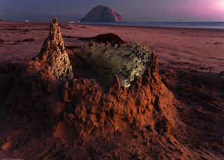 Sandcastle on Morro Strand State Beach, with Morro Rock visible in background, after sunset 24 Aug 2009 | by mikebaird