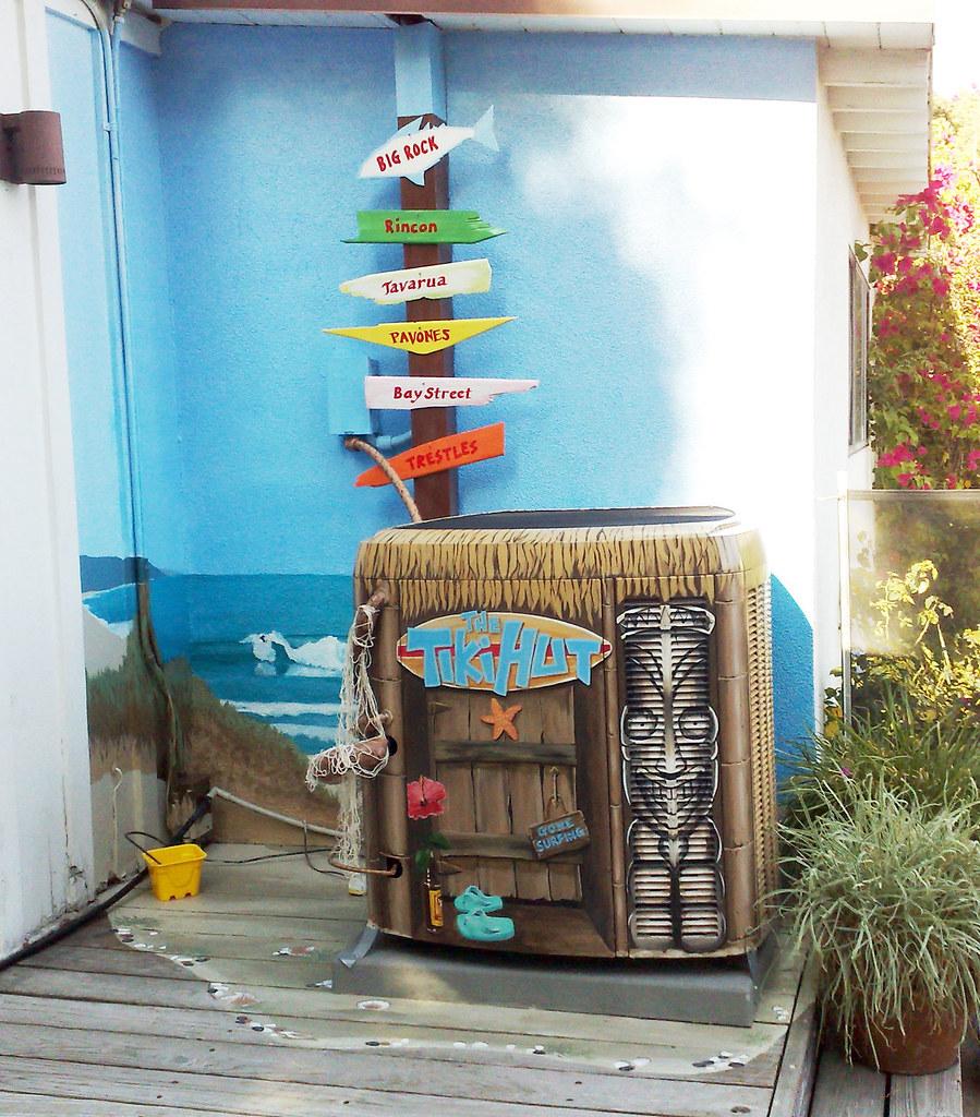 The tiki hut surf shack mural disguising an air condition for Air conditionn mural
