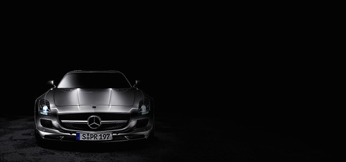 The Mercedes-Benz SLS AMG front view, black background ...