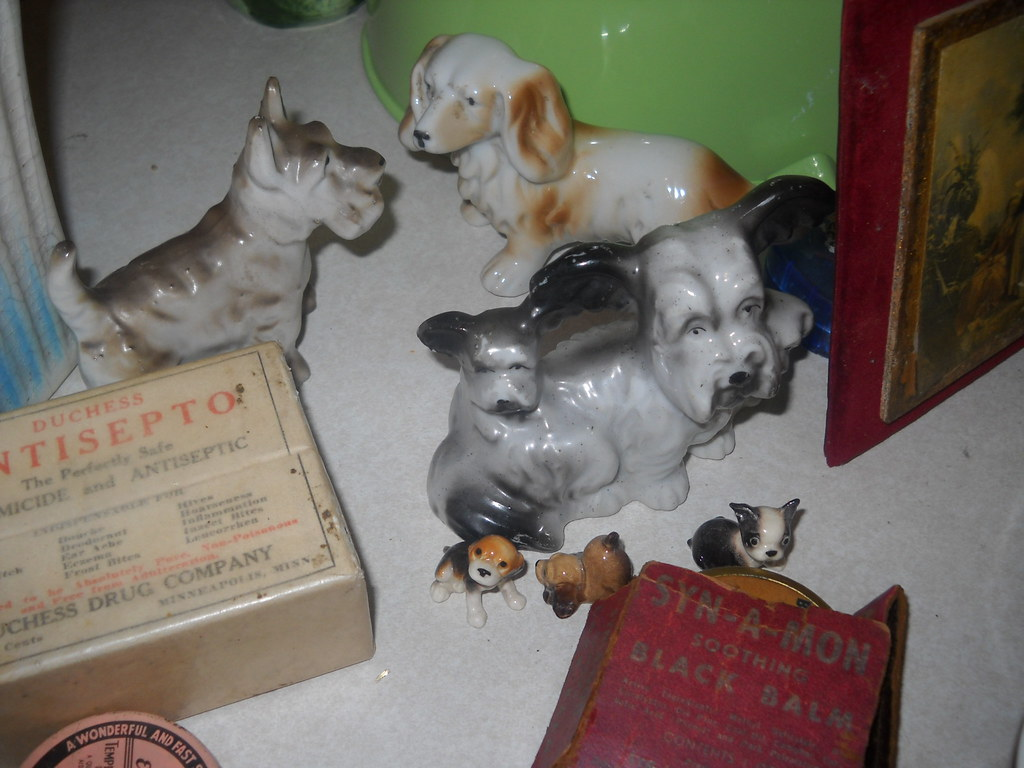 Vintage Ceramic Dogs Holding Court On A Bed Figurine