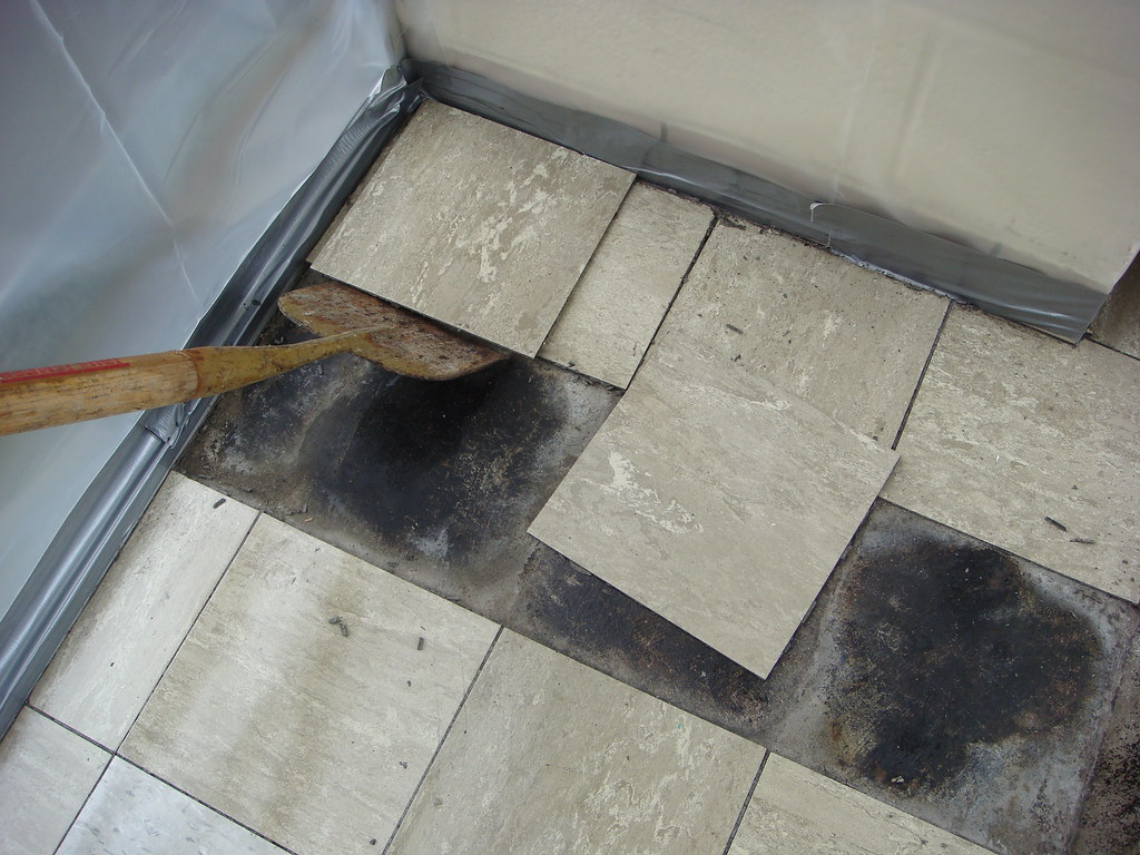 Removal of asbestos floor tiles