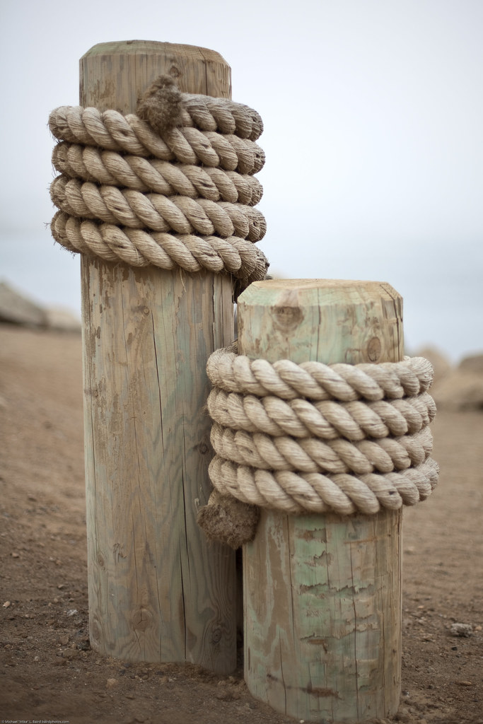 two decorative posts with marine ropes on harborwalk expe