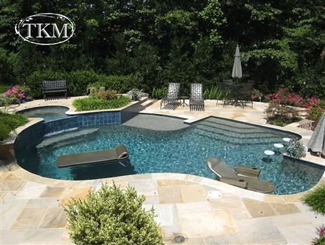 Pool with copper bay flagstone deck pool kings masons for Pool kings design