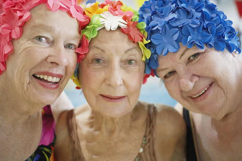 Elderly Women Wearing Colorful Bathing Caps | by homecaregiverstore@gmail.com