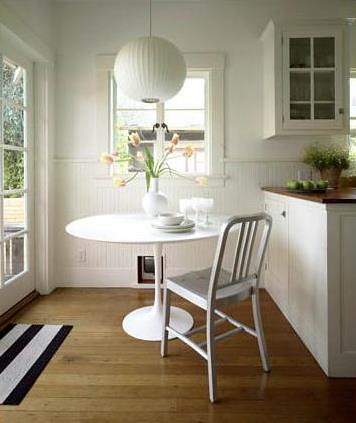 Modern white kitchen Saarinen table Emeco Navy chair