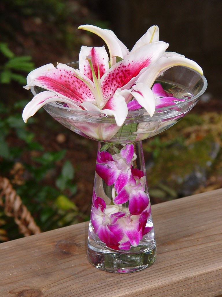 Stargaze lilly and purple dendrobium orchid centerpiece