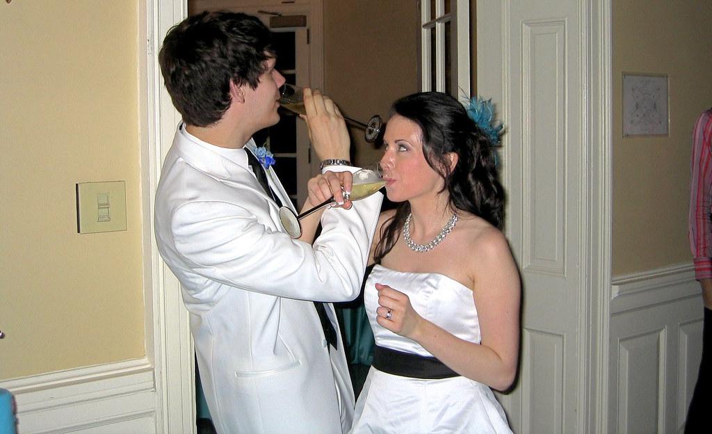 Wedding Reception Cake Tabke With Folowers And Glass On Top