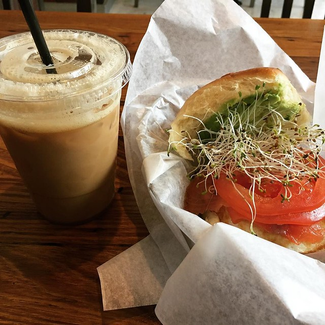 Breakfast. Salmon egg avocado tomato sprouts. Cold brew.