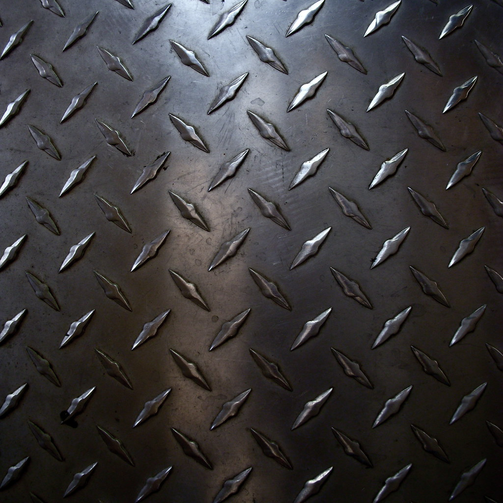 Rough Diamond Plate Metal Worn Plate Metal On The Floor