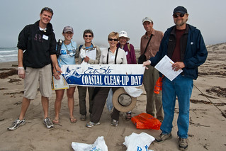 Center team Holds EcoSlo Coastal Clean-up Banner at Ocean's Edge 1 of 2  19Sept2009.  2009 25th Anniversary Coastal Cleanup Field Trip to the Morro Bay, CA Sandspit. | by mikebaird