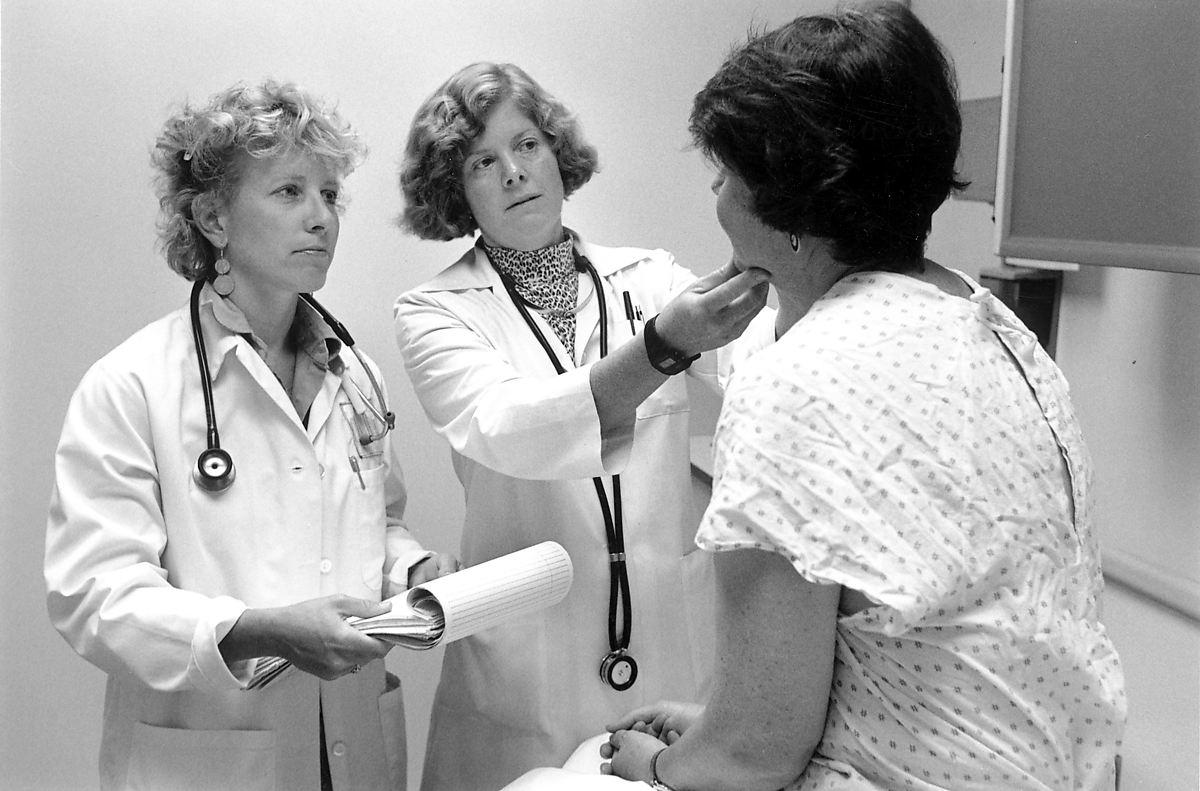 Doctors with patient, 1999