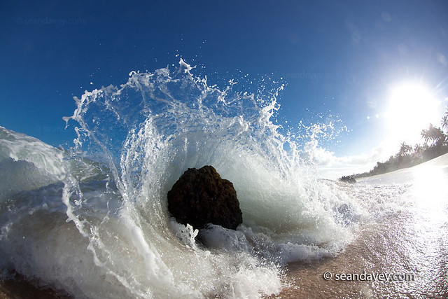 A Wave Crashing To The Beach At Log Cabin On The North Sh