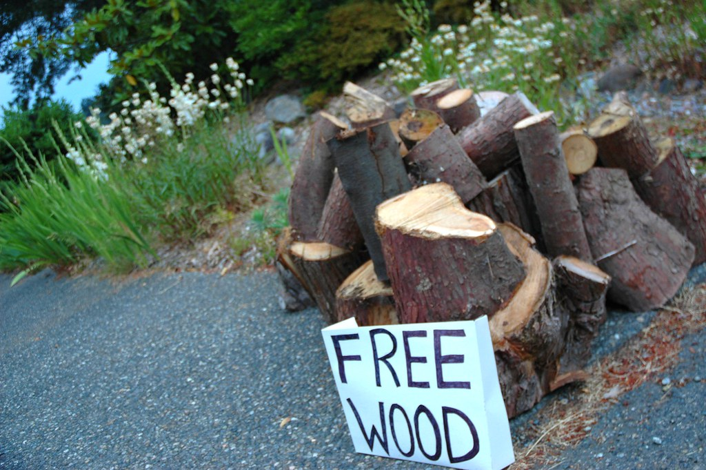 FREE WOOD Sign With Neat Pile Of Logs, Gray Concrete, Whit