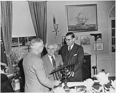 Photograph of President Truman in the Oval Office, evidently receiving a Menorah as a gift from the Prime Minister of Israel, David Ben-Gurion (center), and Abba Eban, the Ambassador of Israel to the United States, 05/08/1951 | by The U.S. National Archives