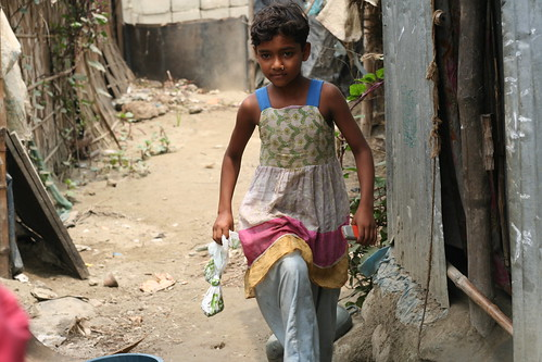 Young girl carrying used bags for collection | by Sustainable sanitation