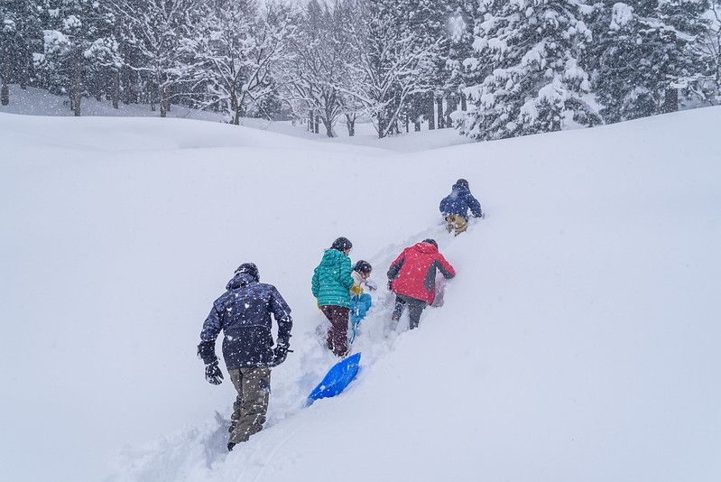 Mountain climbing snowy mountain (to go sledding)