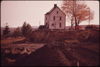 "This House Off Route 250, Has Had Its Windows and Doors Knocked Out, Legally Qualifying It as ""Derelict."" Now the Coal Company Is Stripping Around It. 10/1973 