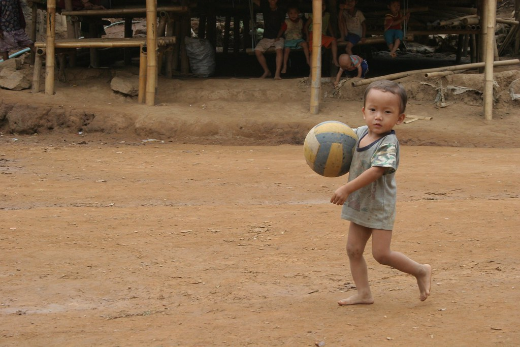 Sport for refugees - Let's Play! | A toddler playing with a ...