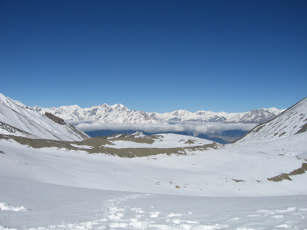 Looking out over Mustang, and towards a new set of mountain peaks, from the Thorong La (5,416 meters / 17,769 feet) - Annapurna Circuit, Nepal