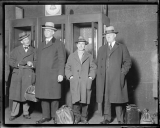 Charles Ponzi after his arrest in Texas after trying to jump to Italy. He is being escorted back to Boston for stay in state prison | by Boston Public Library
