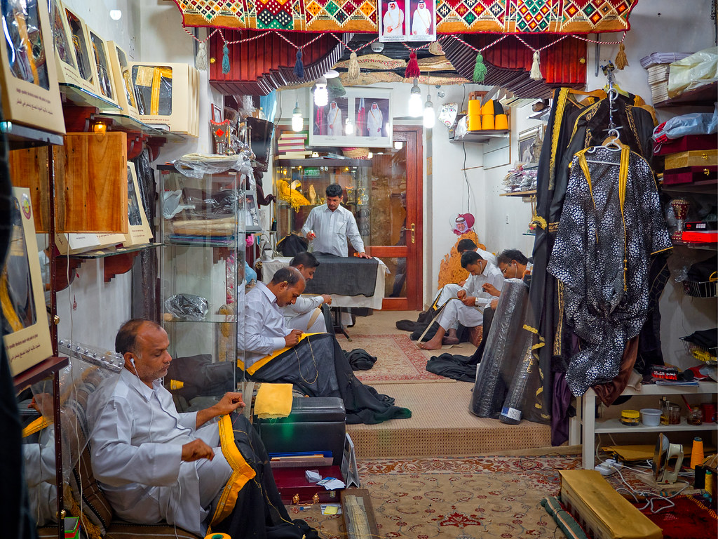 Men working in a clothes shop at Souq Waqif, Doha, Qatar  | Flickr