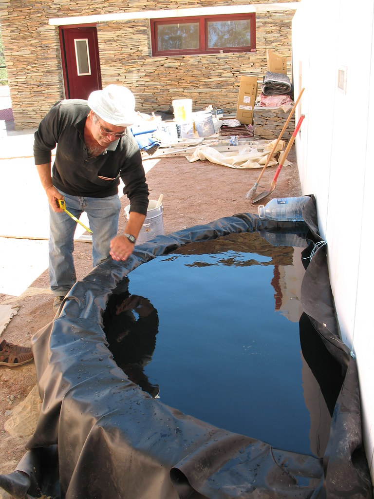Dual layer rubber pond liner being water tested amy for Rubber pond liner