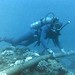 Diver Checking Underwater Protection of Cable