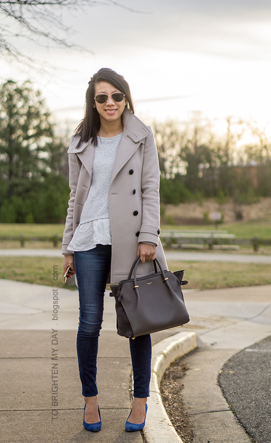 gray wool trench coat, gray ruffled sweater, skinny jeans, gray tote, blue suede pumps